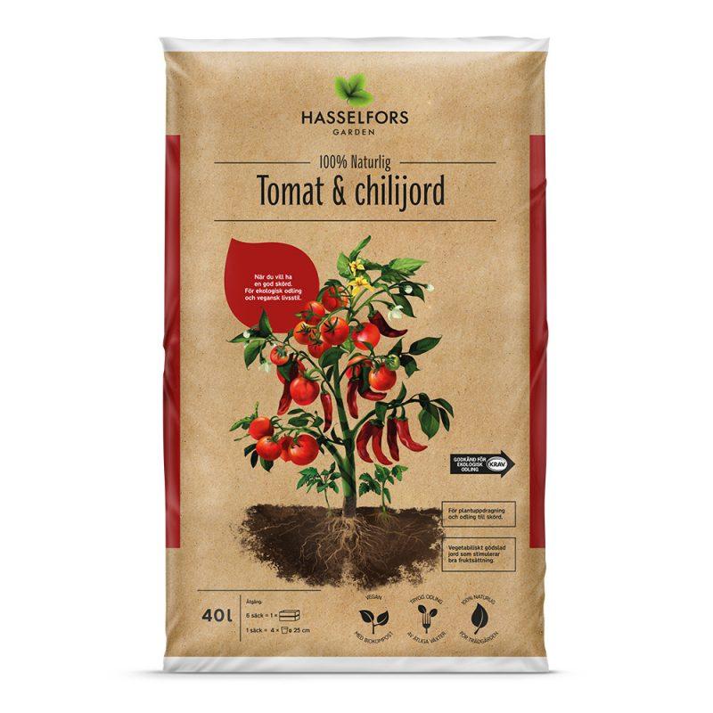 Brun påse men en växt där det växer tomater och chili-frukter